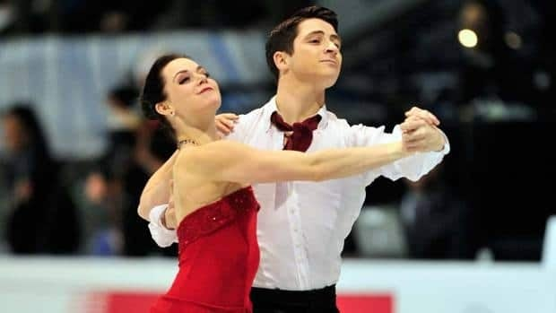 Tessa Virtue, left, and Scott Moir perform their free dance Sunday at the Grand Prix Final in Quebec City.
