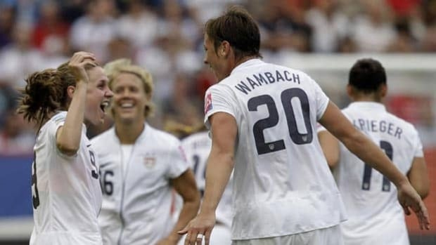 United States' Heather O'Reilly, left, celebrates with teammate Abby Wambach after scoring against Colombia on Saturday.