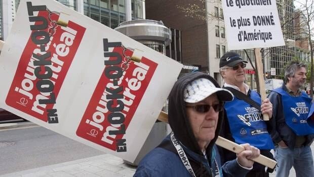 Locked-out employees of Le Journal de Montréal protest outside the Quebecor annual meeting on May 12, 2010, in Montreal. They accepted a contract offer on Sunday after two-thirds endorsed it.