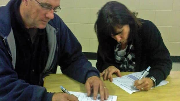 Greater Sudbury residents Peter and Lynne Wade fill out a questionnaire at a recent Cliffs Natural Resources public meeting held in Capreol. The company is looking at building a ferrochrome smelter there.