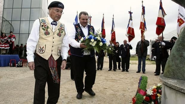 Clement Chartier, president of the Métis National Council, left, and David Chartrand, minister of veterans affairs for the Métis National Council, lay a wreath at a monument during ceremonies to honour Métis veterans of WWII in France on November 2009.