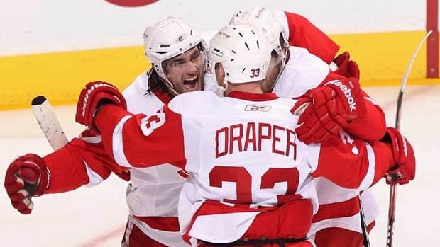 Patrick Eaves of the Detroit Red Wings celebrates with teammates Kris Draper and Darren Helm after scoring in Game 4 against Phoenix.