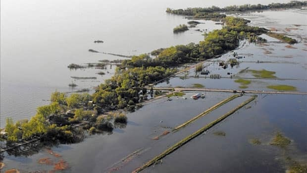 A bird's eye view of the storm damage at Twin Lakes Beach, along the south shore of Lake Manitoba, where violent winds and waves have battered and flooded properties in the past two weeks.