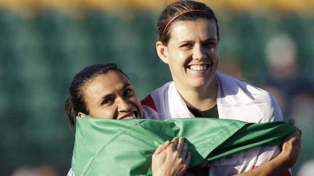 Christine Sinclair, right, is Canada's all-time leading scorer.