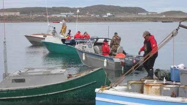 Iqaluit bowhead whale hunters depart in boats from the local breakwater on Monday morning.