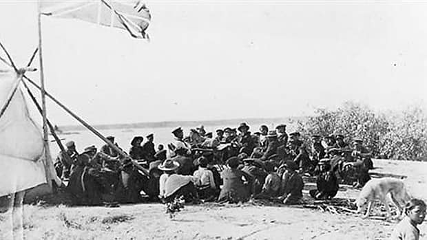 A group gathers in Alberta in 1899 to collect payments from Treaty 8. The Bigstone Cree Nation received more than $231 million from the federal government in December 2010 to settle a specific land claim relating to that treaty. (Glenbow Archives/NA-2760-7)