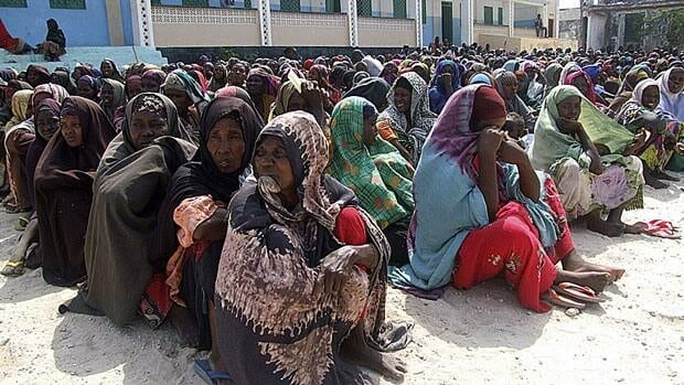 Somali women wait to receive aid at a refugee camp in Mogadishu, July 20. Parts of southern Somalia are suffering from famine, a U.N. official said Wednesday, and tens of thousands of Somalis have already died in the worst hunger emergency in a generation.