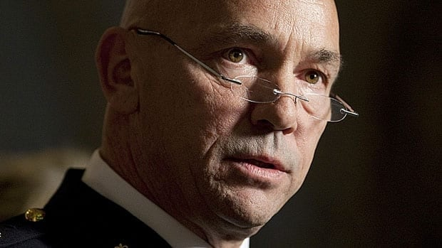 Newly appointed RCMP Commissioner Bob Paulson speaks with reporters in the foyer of the House of Commons Wednesday.
