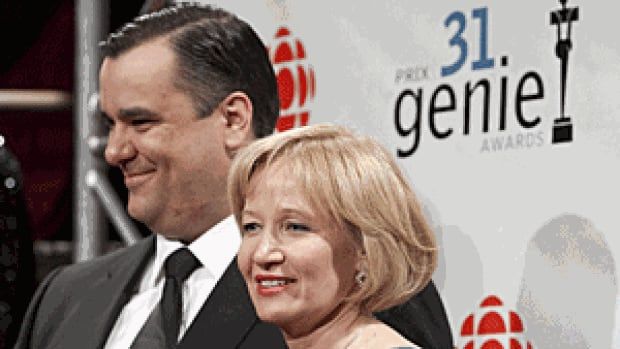 Heritage Minister James Moore with Laureen Harper, wife of Prime Minister Stephen Harper, is seen at the Genie Awards in Ottawa on March 10. Moore said recently, while campaigning for the May 2 federal election, that a promised $25-million endowment fund promised by the Harper government continues to be delayed.