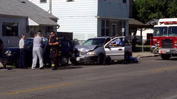 Police attend the scene of a crash between an unmarked photo radar vehicle and a car that slammed into the back of it.