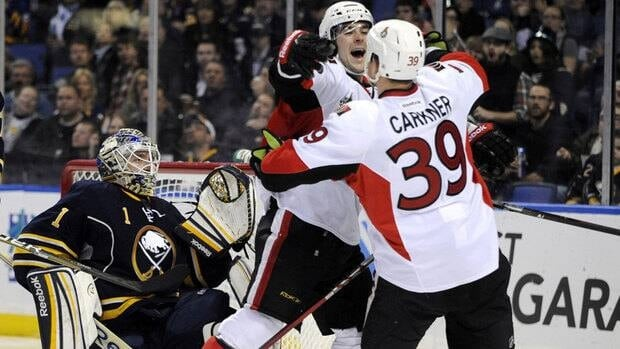 Senators forward Matt Carkner celebrates a goal with Bobby Butler in the second period.