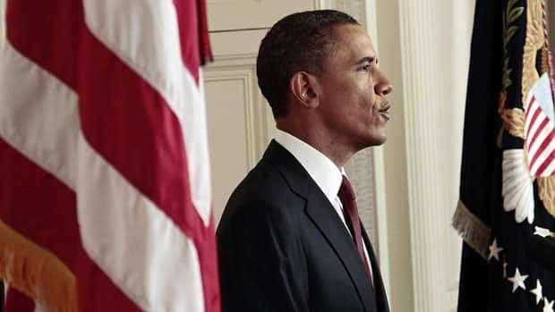 U.S. President Barack Obama reads his statement to photographers after making a televised statement on the death of Osama bin Laden from the East Room of the White House on Sunday, May 1, 2011.