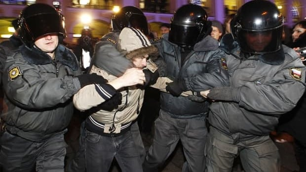 Police detain an opposition activist in St. Petersburg during a protest against the recent election results on Wednesday.