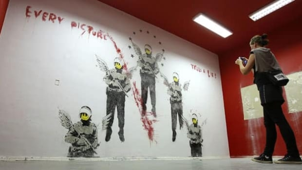 banksy uncovered beneath layers of paint entertainment cbc news. Black Bedroom Furniture Sets. Home Design Ideas