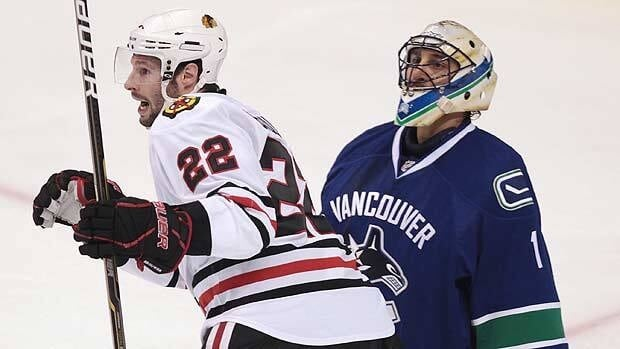 Forward Troy Brouwer celebrates a Chicago goal, one of four allowed before Vancouver goalie Roberto Luongo was pulled.