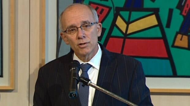 Edmonton Mayor Stephen Mandel speaks to reporters Friday after city council agrees to buy land for the new downtown arena.