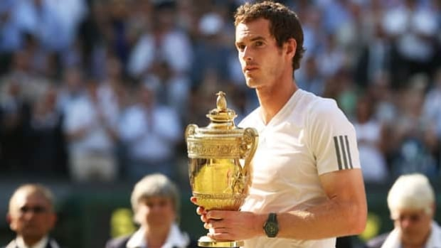 Andy Murray of Scotland holds the gentlemen's singles trophy at Wimbledon on July 7, 2013.
