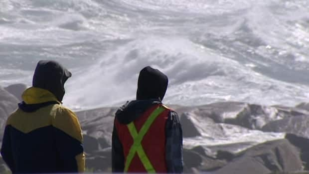 Wave watchers gather at Peggys Cove on Monday.