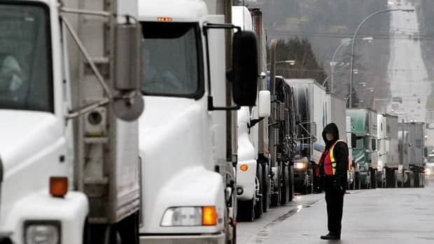 A new agreement between Canada and the U.S. is supposed to ease border conjestion. Trucks line up after arriving at the United States border in Surrey, B.C., March 19, 2003. The trucks were lined up for miles waiting to cross into Blaine, Washington.