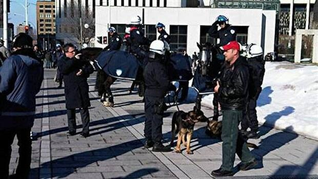 Police on horseback joined sniffing dogs ahead of Tuesday's protest.