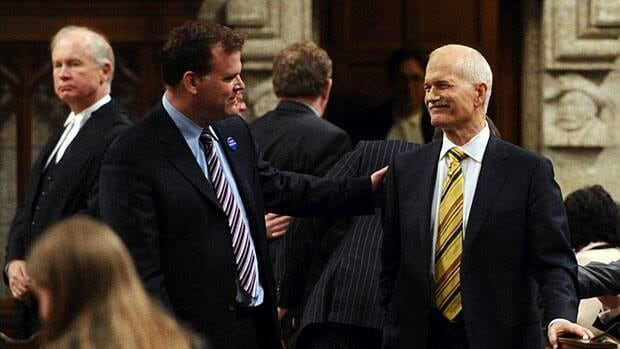 Foreign Affairs Minister John Baird, middle left, pats NDP Leader Jack Layton on the shoulder as they speak on the floor of the House of Commons prior to the election for a new Commons Speaker, June 2, 2011.