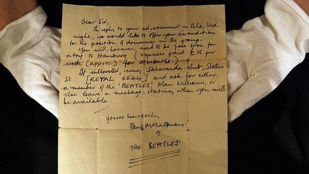 A Christie's employee displays on Monday a letter inviting an unknown drummer to audition for The Beatles. The handwritten letter by Paul McCartney, dated 12 August 1960, will sell at a London auction in November.