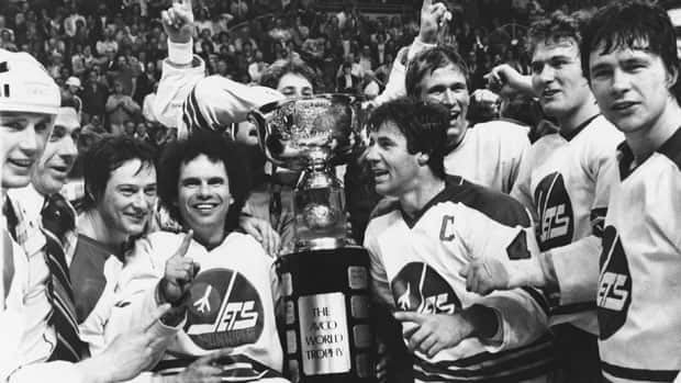 Members of the Winnipeg Jets including captain Lars-Erik Sjoberg (centre right) and Joe Daley (centre left) pose for a team photo with the WHA's Avco Cup after the Jets beat the Edmonton Oilers 7-3 in 1979.