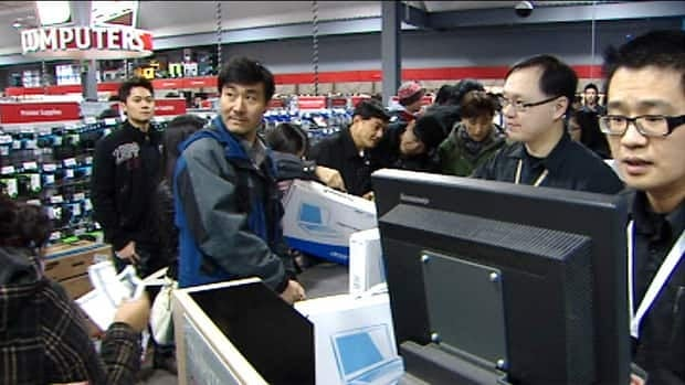 Shoppers in Metro Vancouver flocked to electronics stores for reduced-price laptops, gaming consoles and flatscreen TVs on Monday, but debt counsellors wonder whether the Boxing Day deals were good for everyone.