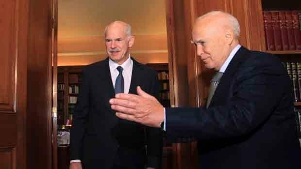 Greek President Karolos Papoulias, right, welcomes Prime Minister George Papandreou at his office inside the presidential palace in Athens.