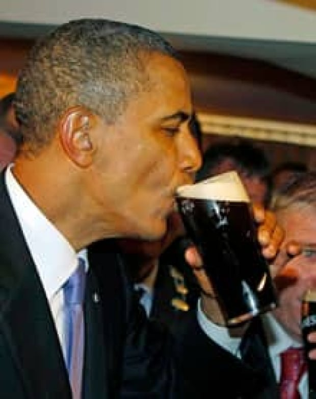 ip-220-obama-drinks-guinness-ireland-ap-rtr2msma