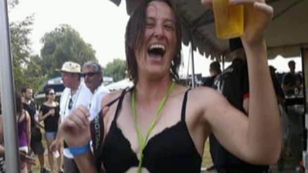 Jeanette Martin enjoys herself at Toronto's annual beer festival.  A short time after this photo was taken security officials told her to put her shirt back on.
