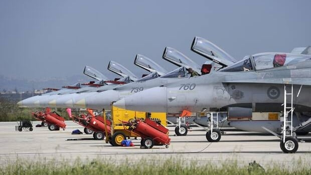 Six CF-18s are prepared for a mission over Libya on March 24 in Trapani, Italy.