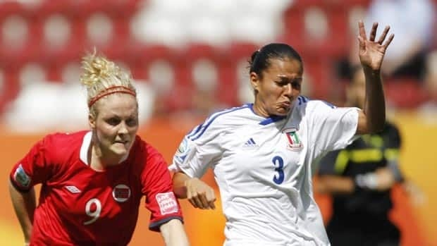 Norway's Isabell Herlovsen , left, and Equatorial Guinea's Dulcia challenge for the ball during Wednesday's game.
