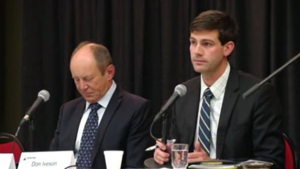 Don Iveson (right) looks exasperated after telling the crowd at Thursday's mayoral candidate forum that wanted to stay positive during his campaign. Earlier in the evening, his opponent Kerry Diotte (left) criticized Iveson for being too young and inexperienced to be mayor.