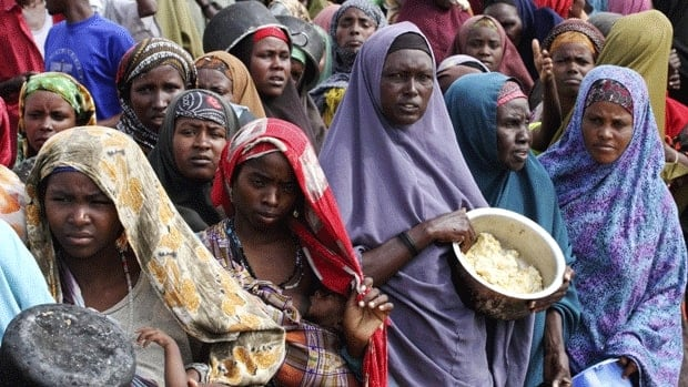 Internally displaced Somali women wait for food at a camp in the Somali capital, Mogadishu, on July 20, 2011. People in the rebel-controlled south and south-central parts of the country, whose livelihoods have been devastated by a combination of factors - from drought to conflict and global rises in commodity prices - have been left no choice but to walk for days to find food. Many of the thousands of families who managed to reach Mogadishu lost children along the way to starvation.