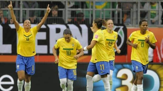 Marta, second from left, scored two goals and set up another by teammate Rosana, far left, in Brazil's 3-0 win over Norway on Sunday.