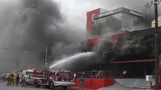 Smoke billows out of a building housing a casino as firefighters try to extinguish the fire after an attack in Monterrey on Thursday.