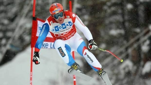 Didier Cuche takes to the air during Saturday's World Cup downhill race at Lake Louise.