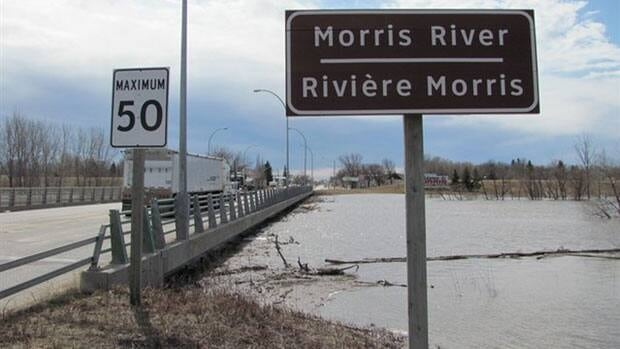 The Morris River is expected to soon wash over the bridge linking Highway 75 to Morris.