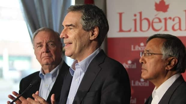 Liberal leader Michael Ignatieff speaks as former prime minister Paul Martin, left, and candidate Ujjal Dosanjh look on during a B.C. campaign stop Sunday.