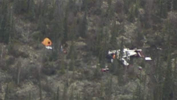 The wreckage of an Air Tindi Cessna 208B that crashed near Lutselk'e, N.W.T., on Tuesday. There were four people on the plane. Two died and two are in stable condition in an Edmonton hospital.