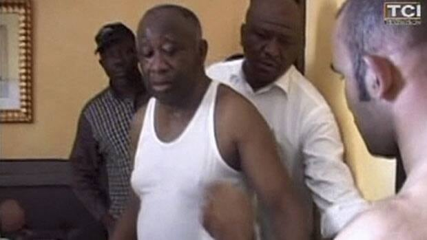 An image from TV channel TCI shortly after his capture shows former Ivory Coast president Laurent Gbagbo, centre, surrounded by men loyal to rival Alassane Ouattara.
