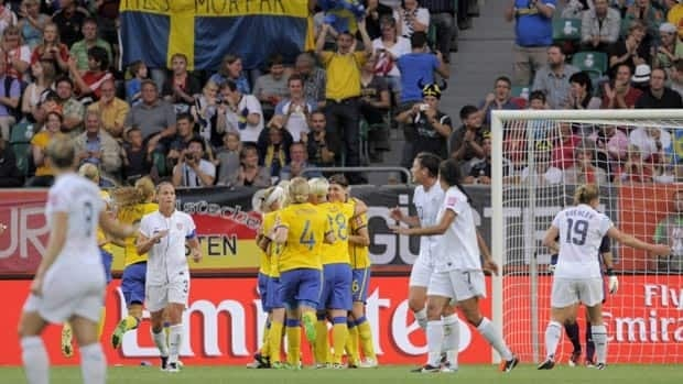 Sweden team members celebrate their opening goal the United States on Wednesday.