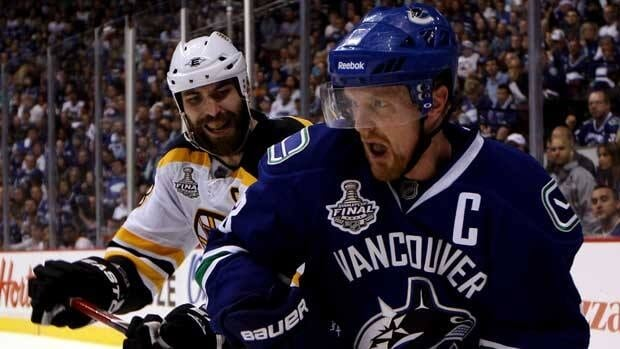 Captains Henrik Sedin, front, and Zdeno Chara each hope to be the first man to lift the Stanley Cup on Wednesday night.