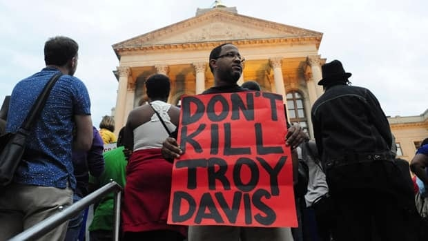 Troy Davis's case became a focus for death penalty opponents because seven of nine trial witnesses have recanted their testimony against him, prompting supporters to say he may be innocent. Davis was convicted of the 1989 killing of police officer Mark MacPhail near a Burger King restaurant in the city of Savannah along the Atlantic coast of the southern U.S. state.