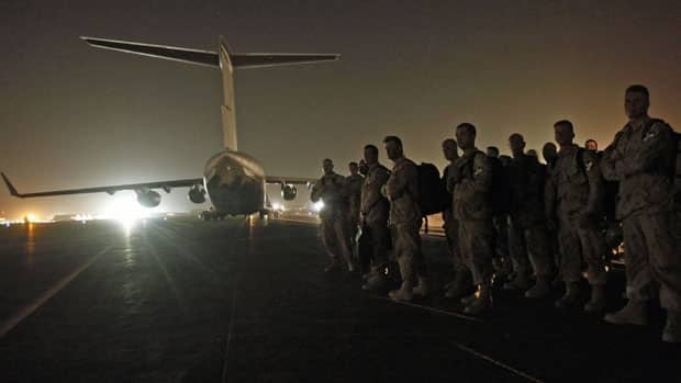 Canadian soldiers walk toward a Canadian air force C-17 aircraft as they prepare to leave Afghanistan, at Kandahar Air Field, June 30, 2011.
