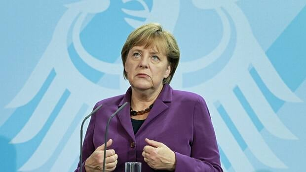 German Chancellor Angela Merkel gestures during a news conference on Tuesday, at which she sought to calm market fears that Greece is heading for a chaotic default on its debts.