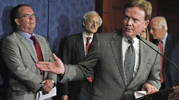 Wartime spending commission co-chairman Michael Thibault, left, Sen. Jim Webb, foreground, and commission co-chair Christopher Shays, right, were among those who spent two and a half years examining waste and fraud in contracting involving Iraq and Afghanistan.