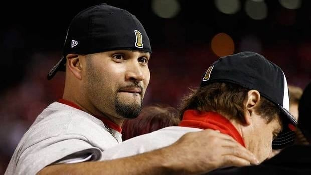 St. Louis Cardinals' Albert Pujols, left, and manager Tony La Russa take in their Game 7 World Series victory.