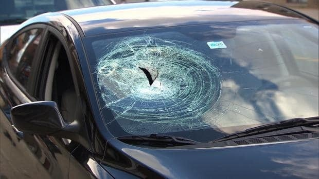 A chunk of concrete the size of a brick smashed a car windshield on Papineau Street Thursday afternoon, injuring a passenger.